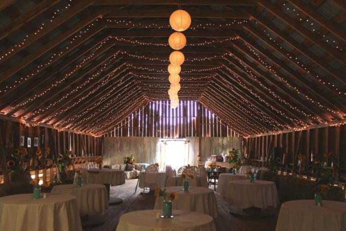 [Image: Like a fairy land: lights lighting up the barn and makes it look like a very romantic place for your wedding reception!]