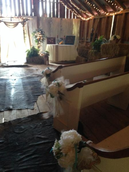 [Image: Sara and Eric laid down authentic cowhide rugs for their walk down the aisle!]