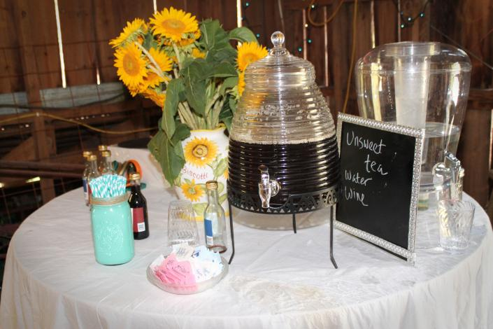 Guests may serve themselves at this table decorated in the bride's colors and according to her theme.