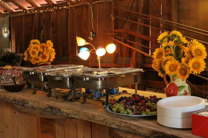 [Image: Contact us to plan your perfect wedding menu!  This table is actually a fourteen foot, rough-sawn wooden slab, cut from a giant elm tree right here at Hidden Valley Guest Ranch.  It rests on wooden spindles, offering just the right country vibe.]